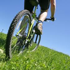 Bicycling at an easy pace for 18 minutes will burn approximately 100 calories.